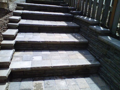 small set of stairs made out of concrete brick pavers. Paver patio, paver patio floor