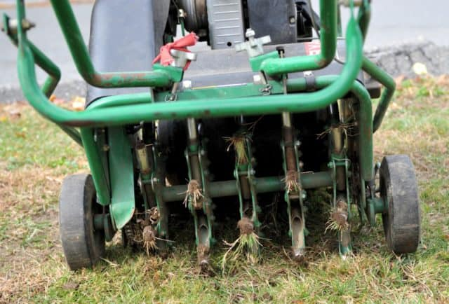 Core Aerator Machine showing the ground being perforated, Lawn Aeration, lawn maintenance, Portland aeration services